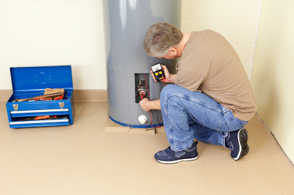 plumber inspects electrical current of water heater in fort worth TX
