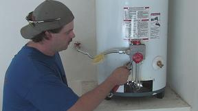 plumbing contractor in Forth Worth Texas works on water heater